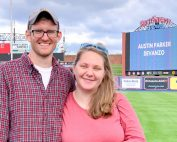 Emma's 36-week bump: Find your community - Pregnant after loss couple with their baby's name on big screen at a field